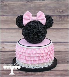 Minnie Mouse cake with ruffles, eyelet lace, and ruffle silhouette topper. www.facebook.com/i.love.cuteology.cakes