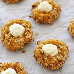 Carrot cake thumbprint cookies -- delicious carrot cake-flavored cookies filled with a tangy, creamy, jam-swirled frosting.