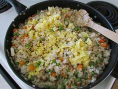 cooked eggs added into fried rice