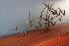 "I think a ""birds in flight"" wall sculpture would look perfect in my sixties house."