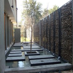 Gabion Wall with Water Feature--Gabion Walls are a very old engineering development--perhaps used by the Ancient Egyptians. I love the use in private residences!