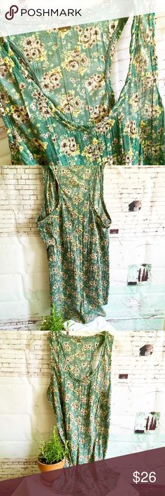 """FREE PEOPLE Green Flowered Racerback Top, Small FREE PEOPLE  Size Small Green flowered racerback is oversized and could fit medium. 29"""" at longest point and 24"""" at shortest. Free People Tops"""