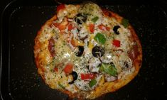 """J's Mini Pizza ~ with Marinara, Mozzarella Cheese, Cheddar Cheese, Garlic Guyere, Stilton Cheese, Bell Peppers, Black Olives, Raw Mushrooms, & Yves """"Pepperoni"""" cooked in butter. (cuz we don't eat pork products). Yum!"""