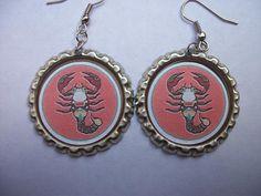 Scorpio bottle cap dangly earrings (BOTTLE CAP ZODIAC EARRINGS by barrelbits on Etsy)