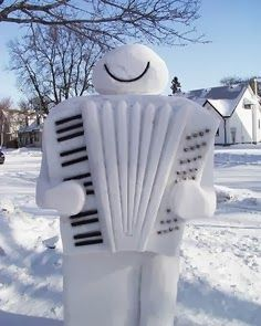 Visit Creativity in the snow! Snowman joyfully playing a quite detailed snow accordion, complete with black dots for stops and piano keyboard style that Lawrence Welk the old guy would've loved for polka dance music! Snow Much Fun, I Love Snow, Winter Fun, Winter Snow, Snow Sculptures, Metal Sculptures, Bronze Sculpture, Wood Sculpture, Ice Art