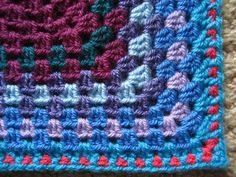 Attic 24: Lucy creates pretty border on awesome granny square patchwork blanket. Link to technique used to keep edge from ruffling.  Also writes out her pattern for the simple granny square.