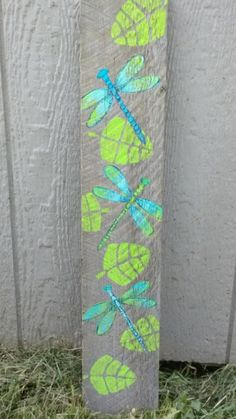 Dragonfly art blue and green painting narrow wall art painting on wood rustic wall decor pallet painting by peppermintpattys on Etsy Dragonfly Painting, Dragonfly Wall Art, Blue Dragonfly, Garden Fence Art, Garden Poles, Big Garden, Terrace Garden, Painting On Pallet Wood, Fence Painting