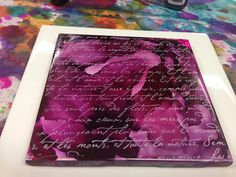 Inky Obsessions : She used black & plum alcohol ink on a white ceramic tile, then stamped French script in white over the whole thing.