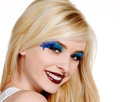 GET THE LOOK | SHOOTING STARS You'll need Glitterbug Skin and Eye Glue, Glitterbug Make Up Brush Kit, Columbia Blue, Teal, and Royal Blue Glitter Dust, and the small Navy Blue Adhesive Glitter Stars. For the lips you'll need Maroon Glitter Dust and Glitterbug Lip Glue. Add your preferred lip gloss for shine!