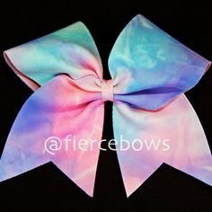 4318 Cotton Candy a fun colorful bow for your collection. Because this is a tie dye style fabric, each bow is unique.Base ribbon is 3 inches.