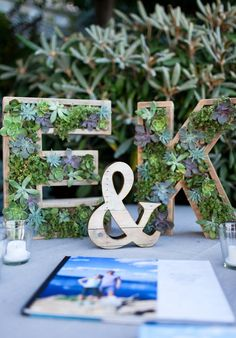 wooden monograms with succulents planted inside are a creative and modern wedding decor idea Wedding Initials, Monogram Wedding, Floral Wedding, Diy Wedding, Wedding Favors, Wedding Flowers, Dream Wedding, Wedding Ideas, Wedding Centerpieces