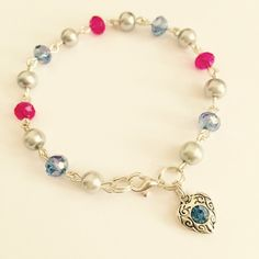 Silver pearl and pink/blue glass bead linked bracelet