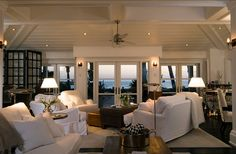 This family room is pure comfort! I love how most of the furniture faces the ocean views!
