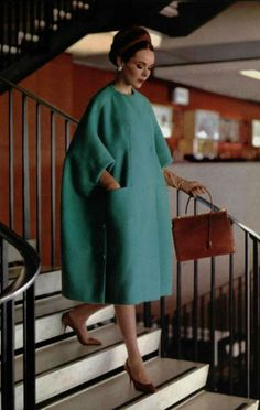 1961 Christian Dior. Just love the coat colour and shape, and the handbag.
