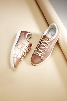 Go for (rose) gold: Add some metallic magic to your shoe collection in the shape of these Le Coq Sportif sneakers.