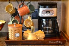 @Brianna Layser we need to find a cute/cheap tray and make a station like this :) The mug hanger is cool too! #coffeestation