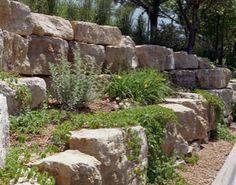 At Boulder Images we design boulder retaining walls that fit into the natural landscape of your backyard.
