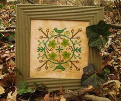 Summer House Stitche Workes Sylvania - Cross Stitch Pattern. Model stitched on 28 Ct. Doubloon Cashel linen by Picture This Plus with DMC floss. Stitch Count: 8