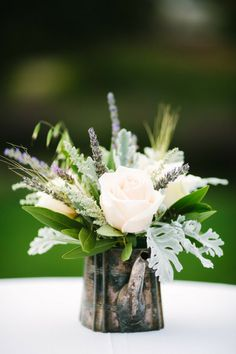 Gallery  Inspiration   Picture - 1631251  (roses, silver senecio cineraria, purple veronica?... ).  Look for cheap silver plate containers / teapots at charity shops and allow to tarnish