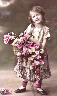 Sweet vintage girl with basket of flowers..