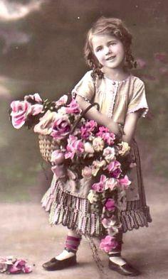 Sweet vintage girl with basket of flowers..