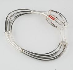 Hybrid bangle by Carlier Makigawa, 2005. Sterling silver, monel, resin, 110 x 75 x 20mm. Photograph by Terence Bogue.