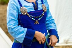 viking apron dress with turtle brooches and beads