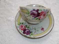 Vintage Nippon Hand painted Victorian Teacup and Saucer..I have theses and the creamer and sugar!!