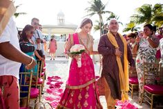 Bride Walking Down the Aisle |  Indian Fusion Wedding | Bridal Lehenga: @Poshaac | Adrienne Fletcher Photography @adrinfletcher | Venue: Moon Palace Golf & Spa Resort in Cancun, Mexico @prweddings