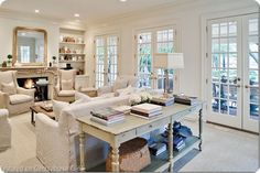 While not on the scale of a Hamptons mansion, the styling and palette of this living space definitely make me feel like I'm right there by the ocean