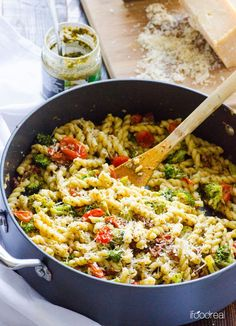 Healthy Pesto Tomato and Broccoli Pasta -- 30 minute pasta skillet with pesto sauce, sun dried tomatoes and Parmesan cheese.