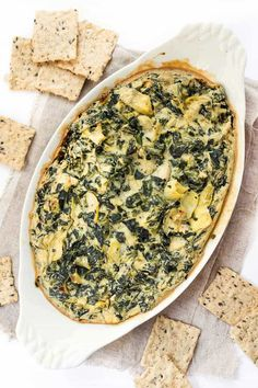 The most INSANELY DELICIOUS Vegan Spinach Artichoke Dip! Less than 10 ingredients, 30 mins and tastes so cheesy!