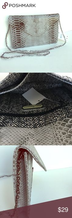 """Brand new Python clutch DETAILS Envelope style clutch with faux python textured finish Magnetic Flap closure with internal zipper pocket Includes detachable dainty chain strap  10.00 """"L x 1.50 """"W x 7.00 """"H Bags Clutches & Wristlets"""