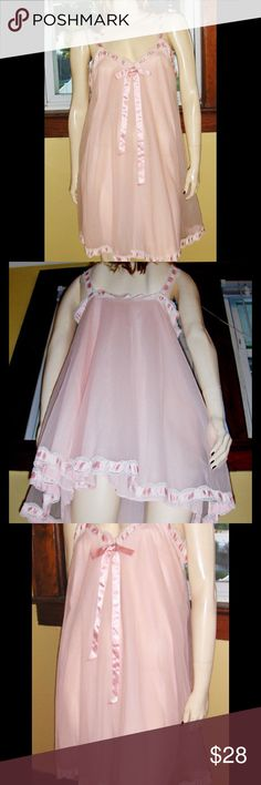 """VTG Pink 60s DBL Nylon LOLITA Babydoll Nightgown Vintage 60s peachy pink babydoll nightgown. Whispery SHEER baby pink chiffon overlay w/underlayer of silky smooth nylon. Sh straps, neckline & hem have pink satin ribbon threaded through frilly scalloped lace giving nighty a sweet Lolita vibe. Accented w/ dainty ribbon bowtie. Full & flairy shaping. Perfect for the Girly-Glam lingerie lover.  Size:M Bust:App 36-38"""" Waist & Hips:Full & free Lgth:App 34"""" shoulder-hem, 24"""" underarm-hem…"""