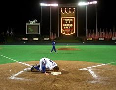 Childhood Idol: George Brett kisses home plate after his last home game in his 20-year career in Kansas City.