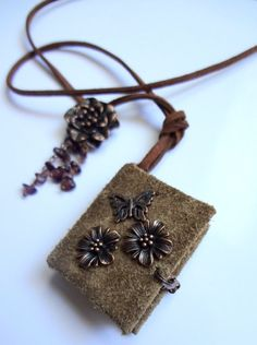 Nice mini-book necklace with aged copper flowers and by swiesele