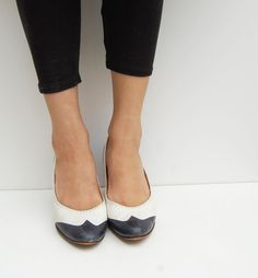 black and white SPECTATOR wood heel shoes 7. $22.00, via Etsy.