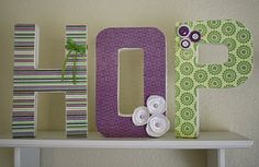 Paper mache letters from Michaels.  Paper decopauged on and embellishments added.