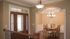Barrington Dining Room and Foyer - Barrington model foyer and dining room feature custom arches and wainscotting