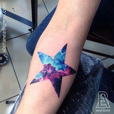 Galaxy star tattoo by Adrian Bascur.