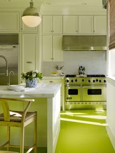 This bright, happy green floor adds so much life and personality to this light, white kitchen. It's a fantastic choice for a modern space