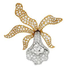 A Life-Like Diamond, Platinum and Gold Floral Brooch. Fashioned as an orchid pavé-set with diamonds, to textured curled sepals and petals, the lip embellished by an old European-cut diamond weighing approximately 0.80 carat, atop a trio of round diamonds, mounted in platinum and 18k gold.