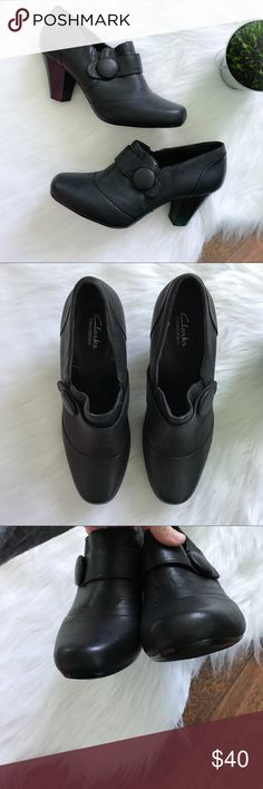 """Clark's Black Leather Button Bootie Heels size 10 Beautiful black leather pull on bootie from Clark's bendables line. Cute oversized """"button"""" accent. Has a mark on the leather and a scuff shown in photos. Feel free to ask questions or make an offer! Clarks Shoes Ankle Boots & Booties"""