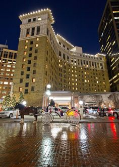 Horse and Carriage ride at Rice Park with The Saint Paul Hotel in the background. Photo by The Saint Paul Hotel.