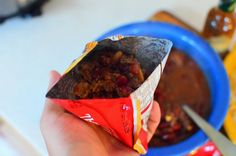 Pressure Cooker Frito Pie recipe - cut open a bag of Fritos, add a scoop of chili, a handful of cheese, sprinkle with chopped onions, and dig in with a spoon. Heaven.
