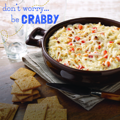 Between game days and holidays, you've got a lot of people to feed. Whip up this Cheesy Hot Crab and Red Pepper Dip to keep your guests happy as a ... crab. ;) #recipe #thanksgiving #appetizer