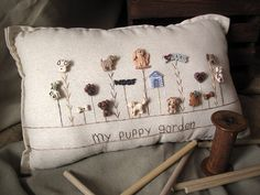 This puppy-themed hand-made muslin needlework pillow is the perfect gift for the dog lover in your life! Size is approximately 16 x 8.