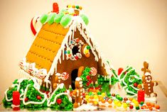 """the tradition of holiday gingerbread houses started with the edible house in the classic Brothers Grimm fairy tale, Hansel and Gretel. When the Brothers first penned the tale in Germany in 1812, they described the witch's house as made """"of bread and covered with cakes, while its windows were of clear sugar."""""""