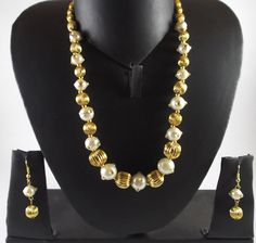Product Type : Imitation Jewellery Colour : Gold Tone and White   Disclaimer :The images represent actual product though color of the image and product may slightly differdue to photographic lighting sources or your monitor settings.. - See more at: http://haveaclick.com/gold-tone-pearl-necklace-set/products/view/52