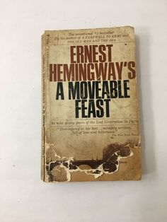 A Moveable Feast by Ernest Hemingway. Circa 1964. Vintage paperback book. Classic literature.